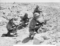 An Australian patrol lays up in an anti-tank ditch near the perimeter of the Australian defences around Tobruk, pin by Paolo Marzioli