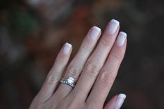 French manicure with shellac polish for my sister-in-law's wedding. The nail polish goes great with my engagement and wedding ring.