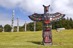 First Nations Totem Pole Thunderbird and Copper in the village of Alert Bay in British Columbia