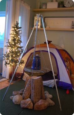"""Set up a """"camp scene""""; this would be great when stuck inside during a cold winter"""