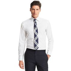 Tommy Hilfiger men's shirt. What we do best—the expertly tailored dress shirt in pure, premium cotton. <br/>• Custom fit (a tailored version of our classic fit, cut slimmer through the chest and shoulders).<br/>• 100% cotton.<br/>• Spread collar, contrast under cuffs.<br/>• Machine washable.<br/>• Imported.<br/><br/>
