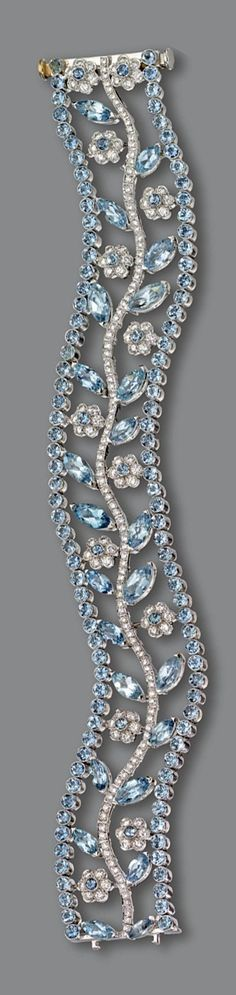Auamarine and diamond bracelet. Openwork serpentine band decorated with a central branch supporting flowers and leaves, set with marquise-shaped and round aquamarines as well as numerous small round diamonds, mounted in platinum, length Aquamarine Jewelry, Diamond Jewelry, Diamond Pendant, Diamond Rings, Diamond Choker, Diamond Gemstone, Gold Ring, Bling Jewelry, Jewelry Bracelets