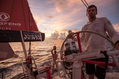 February 20, 2015. Leg 4 to Auckland onboard Dongfeng Race Team. Day 12. Kevin Escoffier takes a shower while Thomas Rouxel helms - Sam Greenfield / Dongfeng Race Team / Volvo Ocean Race
