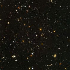 An estimated 10,000 galaxies are revealed in humankind's deepest portrait of the visible universe ever: the Hubble Deep Field. All but three points of light in this picture are entire galaxies unto themselves - and that only represents the equivalent of dime's worth of the night sky at 75 feet away