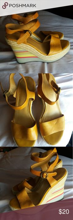 Nine West Vintage America Wedges Absolutely adorable shoes! Extremely comfortable too! These are in great condition, only worn a few times. Only signs of wear are a few small marks on the wedge as pictured, but these are hardly even noticeable in the photo.   The mustard yellow color is beautiful and the stripes on the wedge make these shoes pop! These shoes are a must have for this spring and summer! Nine West Shoes Wedges