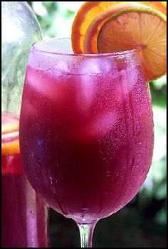 Best Party Sangria - served this at our annual cookie exchange party over the Christmas holiday, only changed gin to triple sec. Used frozen berries, thus needed less ice (less diluting that way!) Plenty to go 'round & yummy. Puerto Rican Dishes, Puerto Rican Cuisine, Puerto Rican Recipes, Puerto Rican Sangria Recipe, Party Drinks, Cocktail Drinks, Fun Drinks, Alcoholic Drinks, Beverages