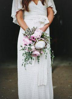 Luxe Bohemian Chic Wedding- Boho wedding dress and pink protea wedding bouquet Bouquet De Protea, Bouquet Bride, Pink Bouquet, Protea Wedding, Cascading Wedding Bouquets, Bridal Flowers, Lilac Wedding, Boho Wedding, Wedding Inspiration