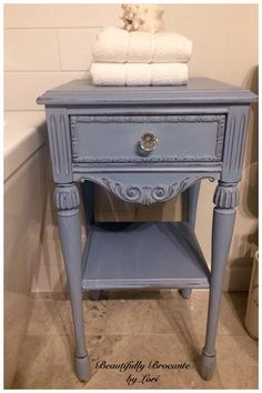 Antique side table painted in Annie Sloan chalk paint Louis Blue, distressed and clear waxed. New glass knob for some bling!