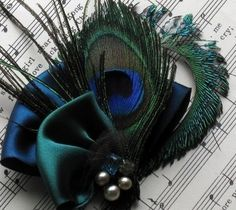 Tips on DIY Feather Bouquet? :  wedding peacock feather turquoise teal sapphire blue green bouquet Fascinator