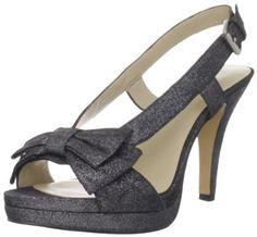 """Black Nine West Womens Darlin Slingback Sandal  Kick out in sumptuous style in this slingback sandal from Nine West. The Darlin captures hearts with a leather and fabric upper that features a bow detail on the toe strap. Beneath, a covered platform adds comfort, while balancing the high heel in back. Leather and fabric upper and Manmade sole. Heel measures approximately 3.5"""". Platform measures approximately 0.5"""". Synthetic lining. bows Color: black leather"""