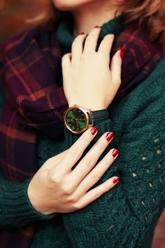Green watch face.  Green sweater.  Red nail polish. Red plaid scarf. Classic Christmas - but can wear all through the fall and winter too