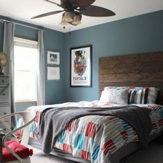 Gretchen from Boxy Colonial redid her tween boy's room, and he actually picked the color! I'd say he definitely has an eye for these things. The gray blue looks great with the rustic headboard, red, and gray accents. The paint color is Martha Stewart Kerry Blue... #marthastewartkerryblueterrier