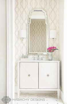 Chic art deco powder room features an accent wall clad in cream and grey trellis wallpaper lined with an art deco mirror illuminated by polished nickel . Grey Trellis Wallpaper, Wallpaper Accent Wall Bathroom, Powder Room Wallpaper, Wall Paper Bathroom, Neutral Wallpaper, Wall Mirror, Wall Sconces, Bad Inspiration, Bathroom Inspiration