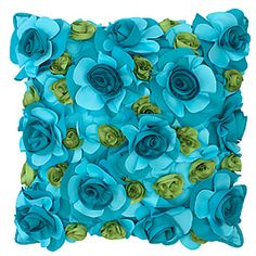 """""""this fabulous pillow is made of layers of laser-cut petals of polyester oxford, hand-stitched to form a cover of bright Aquamarine and Green flowers. Best of all, the fabric is water, stain, and soil repellant."""""""