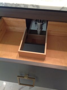 pull out drawer built around plumbing.. Such a better use of space than a cabinet under the sink