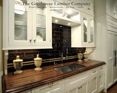 """Grothouse Wood Countertop 2-1/2"""" Walnut with Sapwood in brown color with a Large Bead and Cove edge profile and a Durata Finish. Special feature is an Undermount Sink. Designed by Vincent Cappello, Putnam Kitchens."""