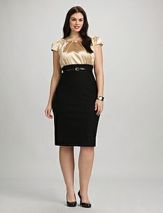 We can't get enough of wear-to-work pieces that pull double duty. That said, we think this is the dress you'll want to wear from morning meeting all the way through after-hours. Light gold bodice; black skirt. Removable black patent belt; belt loops. Pleated at front of neckline. Scoop neck. Wide banded waist. Bodice lined only; center back hem vent.