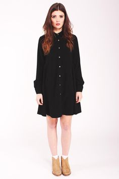 Black shirt dress. Relaxed fit. Button through front. Flared skirt.