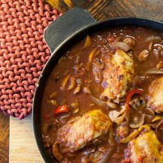 Chicken cacciatore, hunter-style with mushrooms and peppers in a magical, deeply herbaceous sauce.