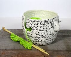 Ready to ship Wide 5 height 4 This sheep yarn bowl is made with a white low fire casting slip. The mold is designed and made by me. I animated each one adding ears, eyes ,tail Painted with underglaze and glazed with transparent glaze Thanks for visiting. Ceramic Pottery, Ceramic Art, Ceramic Wool, Crochet Jar Covers, Wooden Yarn Bowl, Crochet Bowl, Crochet Storage, Yarn Ball, Knitting