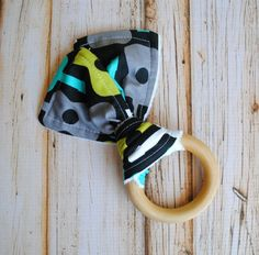 Baby Teething Toy- Teething Buddy- natural maple wooden teething toy with terry cloth and cotton fabric on Etsy, $12.91