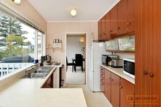 Kitchen 1990's style in 3 bedroom block and wood home @ Rangitoto Terrace, Milford. (in Dec 2012)