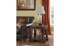 Old world style brown wooden end table with bottom storage area for your living room décor