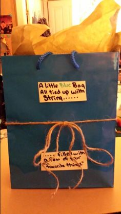This is my version of the paper bag gift. I think it is cute and I hope he likes it.