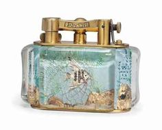 A DUNHILL AQUARIUM TABLE LIGHTER | MID-20TH CENTURY | Interiors Auction | mid 20th Century, cigarette lighter | Christie's