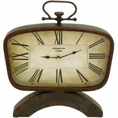 "Weathered metal table clock with a vintage-inspired design.    Product: Table clockConstruction Material: MetalColor: Antique red Accommodates: (2) AA Batteries - not included Dimensions: 13"" H x 15"" W x 2"" DCleaning and Care: Wipe with a dry cloth"