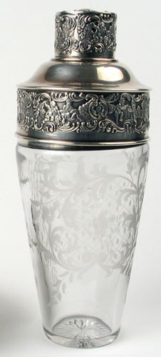American Chatillon Co. Sterling silver and engraved glass martini shaker, c.1900. This fine quality antique cocktail shaker features a beautiful etched pattern on the glass and sterling silver lid, cap and rim.
