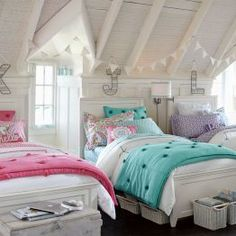 I love the letters above the beds and the white with just the pop of color for the bedding. Would be easy to change room colors