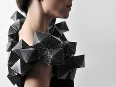 Inspired by Plato, the Greek philosopher, Amila Hrustic created a collection of five unique paper dresses that explore the shapes of Platonic solids.