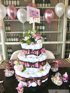 Instead of having a real cake maybe a diaper cake and then a few sweet treats I think I like this idea.