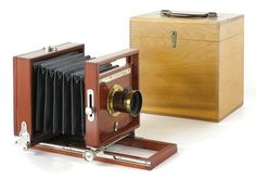 "Antique Camera: ""Peerless Camera"" made by the Rochester Optical Company (c.1887). This is a front focusing field view camera with a highly polished mahogany body, cherry bed, and brilliant nickel trim."