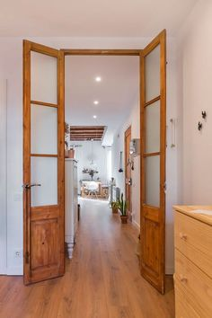french doors in barcelona apartment. / sfgirlbybay - March 05 2019 at House, Interior, Home, Wood Doors, Doors Interior, Internal French Doors, Rustic Remodel, French Doors Interior, Barcelona Apartment