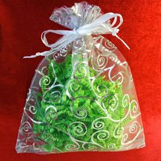 30 Organza Gift Bags (White and Silver Details) => Details can be found  : Wrapping Ideas