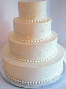 Cute and simple wedding cake - add some flowers?