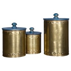Shimmering gold-hued bases topped with bold blue lids set these canisters apart atop the master bath vanity or entryway console.  Pr...
