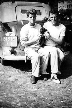 John F. Kennedy and his best friend K. LeMoyne Billings wifh Dachshund