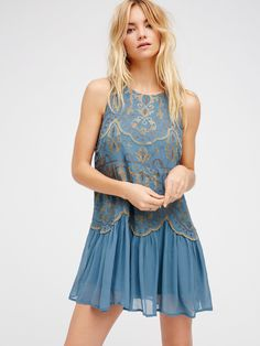 Little Secrets Mini Dress | Boho-inspired drop waist mini dress in a sleeveless silhouette featuring beautiful embroidery detailing. Pull-on style with a rounded neck.