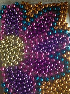 Cut And Glue Old Mardi Gras Beads To Create Beautiful Pieces Of Art You Can Frame As Decorations
