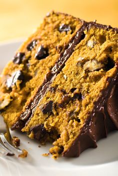 This rich and decadent spiced pumpkin cake is just the thing to serve for an autumn celebration, Thanksgiving or otherwise Chocolate chips and chopped pecans are added to the pumpkin batter for extra sweetness and a bit of welcome crunch For those who like to plan ahead, it can be made and frozen – iced and all