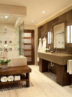 Natural stone and pebbles can make a bathroom feel like a spa bathroom.