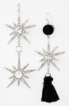 These mismatched crystal and tassel earrings look just like snowflakes!
