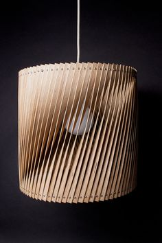 Upcycle, bent slivers of plywood offer a delicate interplay of shadow and light.