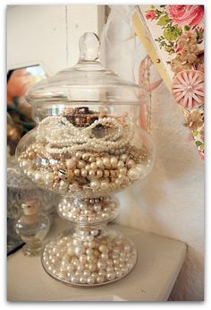 Pearls. Love, love, love this! Great idea for storing necklaces and hide some brooches amongst them.
