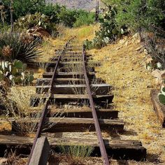 """Repost from one year ago when I hardly had any followers at all. The old railings of mining cart tracks for carrying rock and tailings from the one of the many mines to a processing area or the train station in Chloride Arizona. This """"living ghost town"""" 22 miles north of Route 66 and Kingman Arizona pretty much defines """"off the beaten track"""" but it is very much worth a stop over if you are traveling on Hwy 93 to or from Las Vegas and/or Hoover Dam. This is the west as it really once was…"""