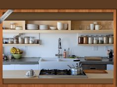 I love the simplistic open shelving. Love this kitchen