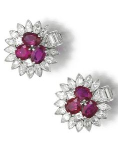 Pair of ruby and diamond earrings, Cartier, 1930s Each designed as a cluster set with three oval rubies within a surround of marquise-shaped, step-cut and triangular diamonds, each signed Cartier, numbered, maker's marks, post and hinged back fittings, fitted case by Cartier.